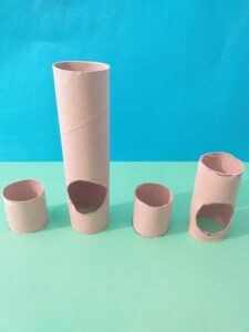 Cut out holes using tube for guide.
