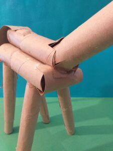 Use glue to hold in place once inserted 4 legs.