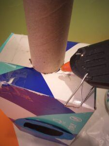Draw around tube, cut out and insert,  hot wax it to secure.