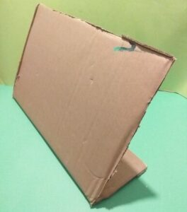 4.  Find approx. A3 cardboard with flap to prop it up.
