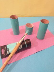 5. Paint two and half tubes with turqoise paint.