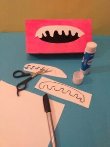 2. Draw size of halve an oval and draw top and bottom teeth cut out.