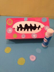 4. Cut out coloured dots and glue onto box.