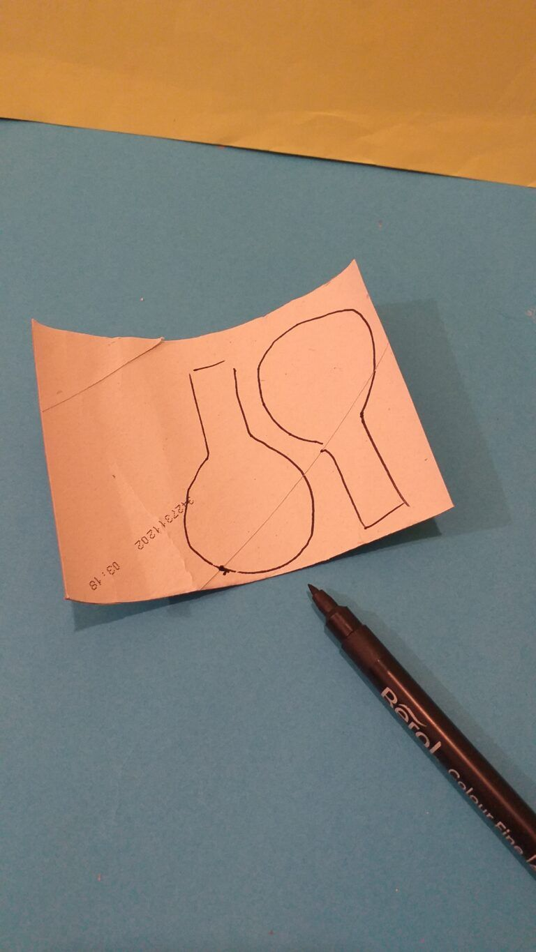 11. With the 3rd tube cut open and draw 2 large spoon shapes. Make sure one side of the tube is white, so as to paint the eyes.