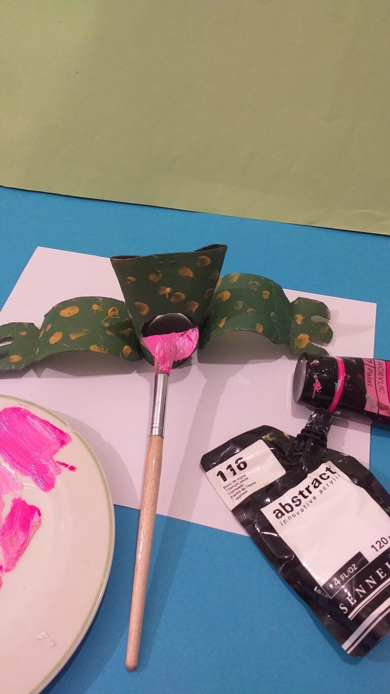 16. Paint inside of the frogs mouth in pink.