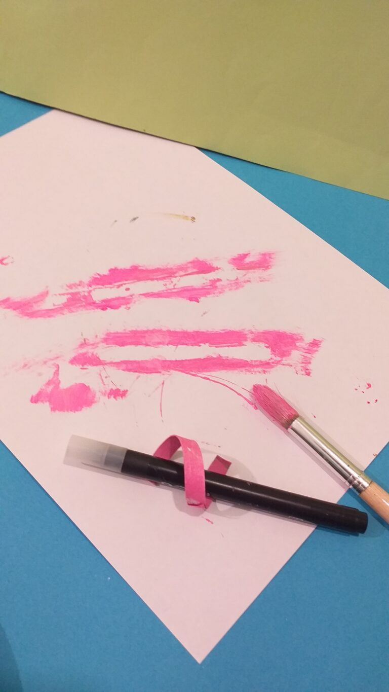 17. Paint the strip in pink, curl around pencil.