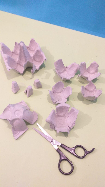 10) Trim off rough edges and cut 4 petal shapes on each egg cup.