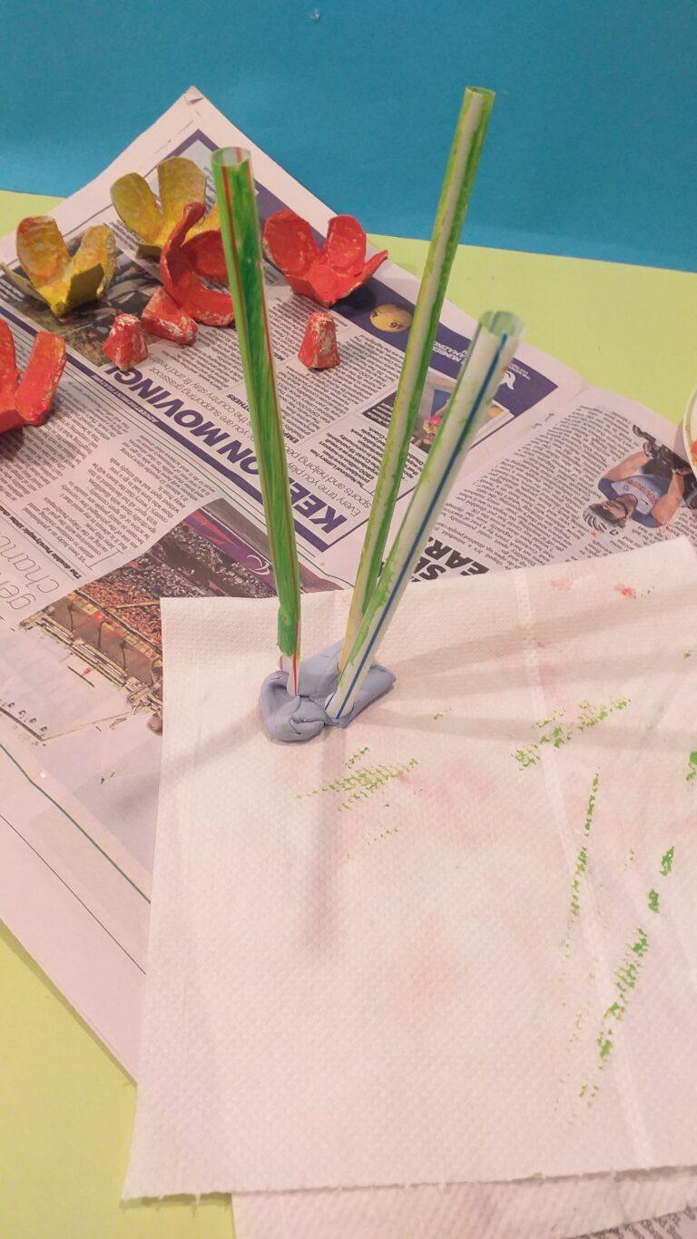 18) To help use blu tack to hold straws whilst you paint them.