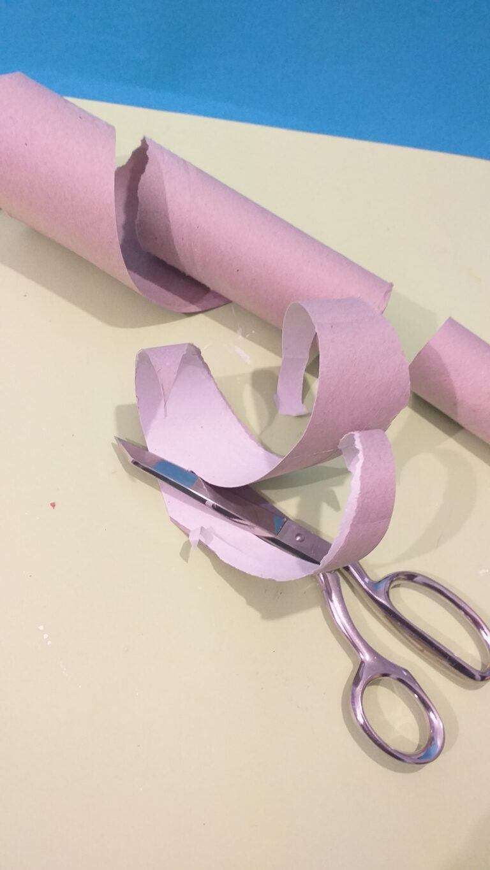 21) Following diagonal line of tube cut strips.