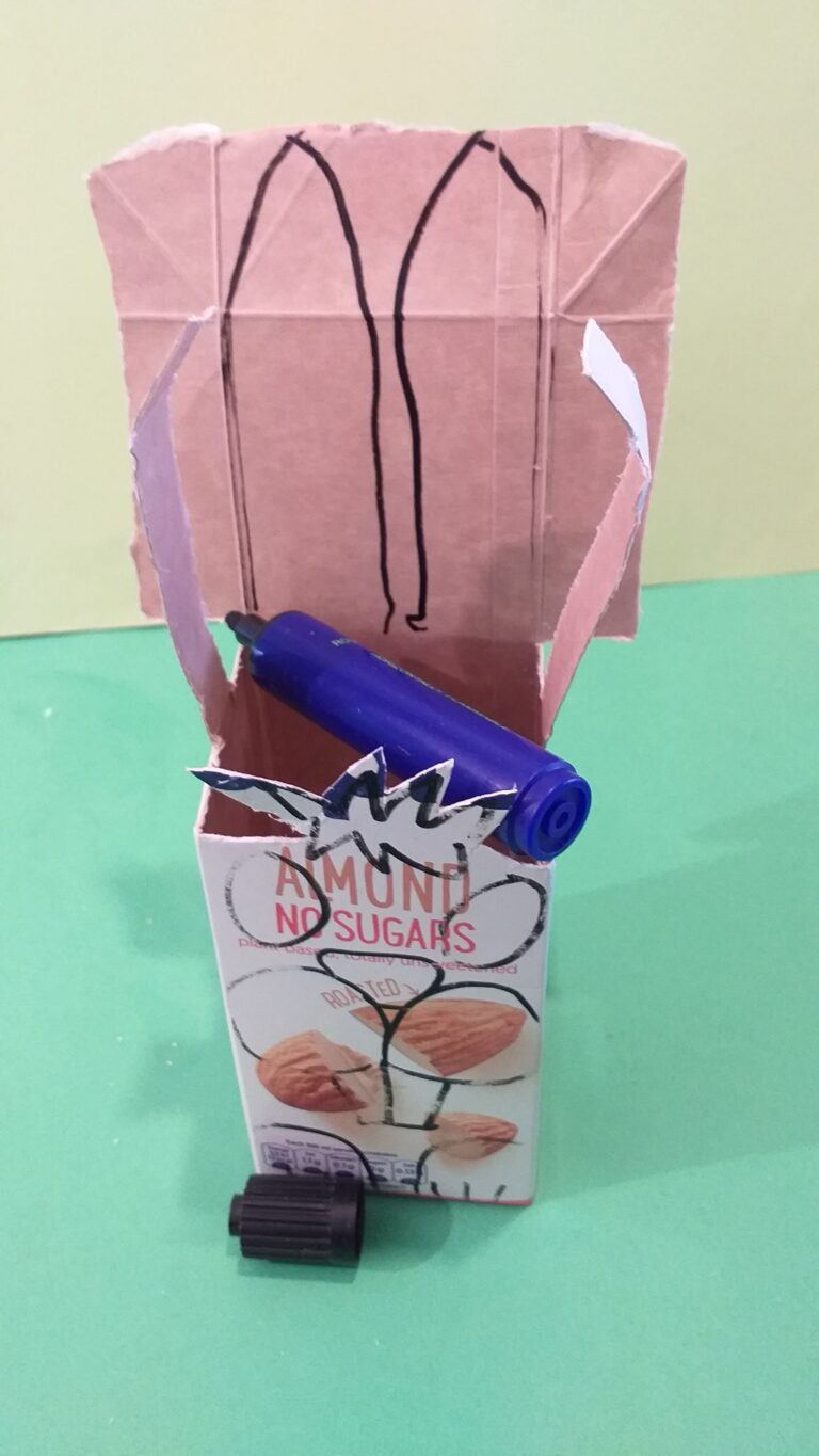 9) Draw the ears on the back of carton.