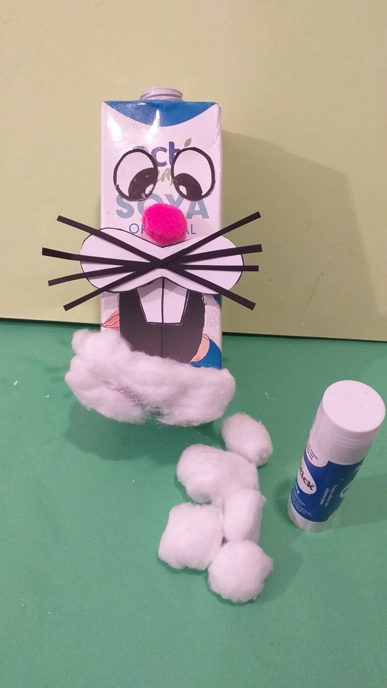 16) Now start to spread the cotton wool balls and glue all around the carton.