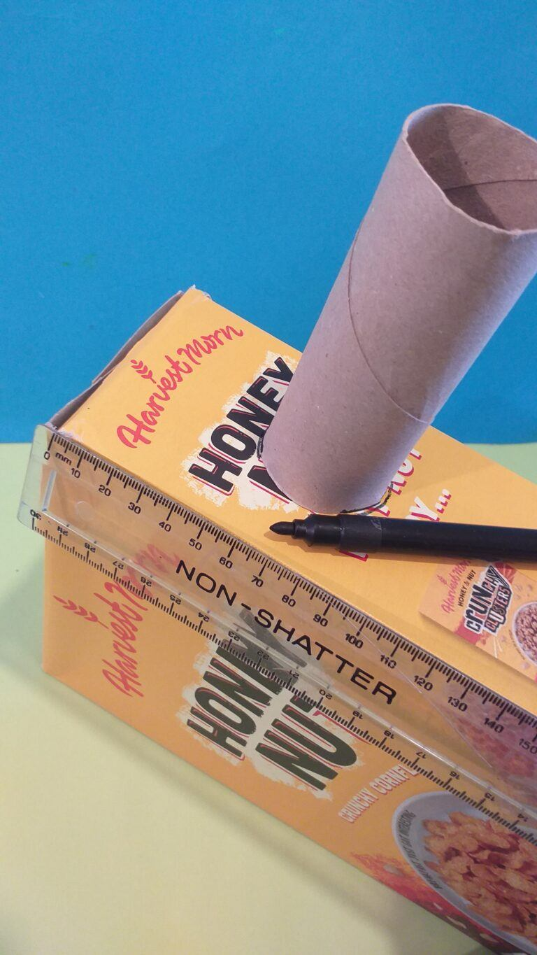 3) Measure down approx. 50mm mark it and draw around the thinner tube.