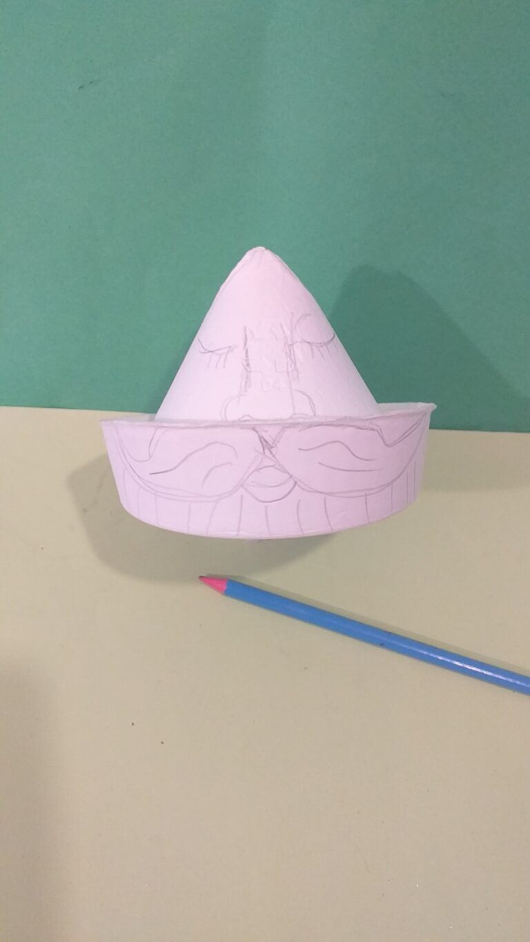 4. With pencil lightly draw a face and large moustache on the outer ring.