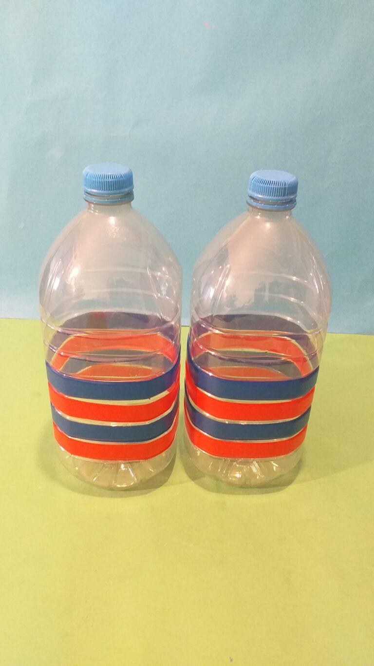 1) Tape up you 2 bottles with tape as you like.