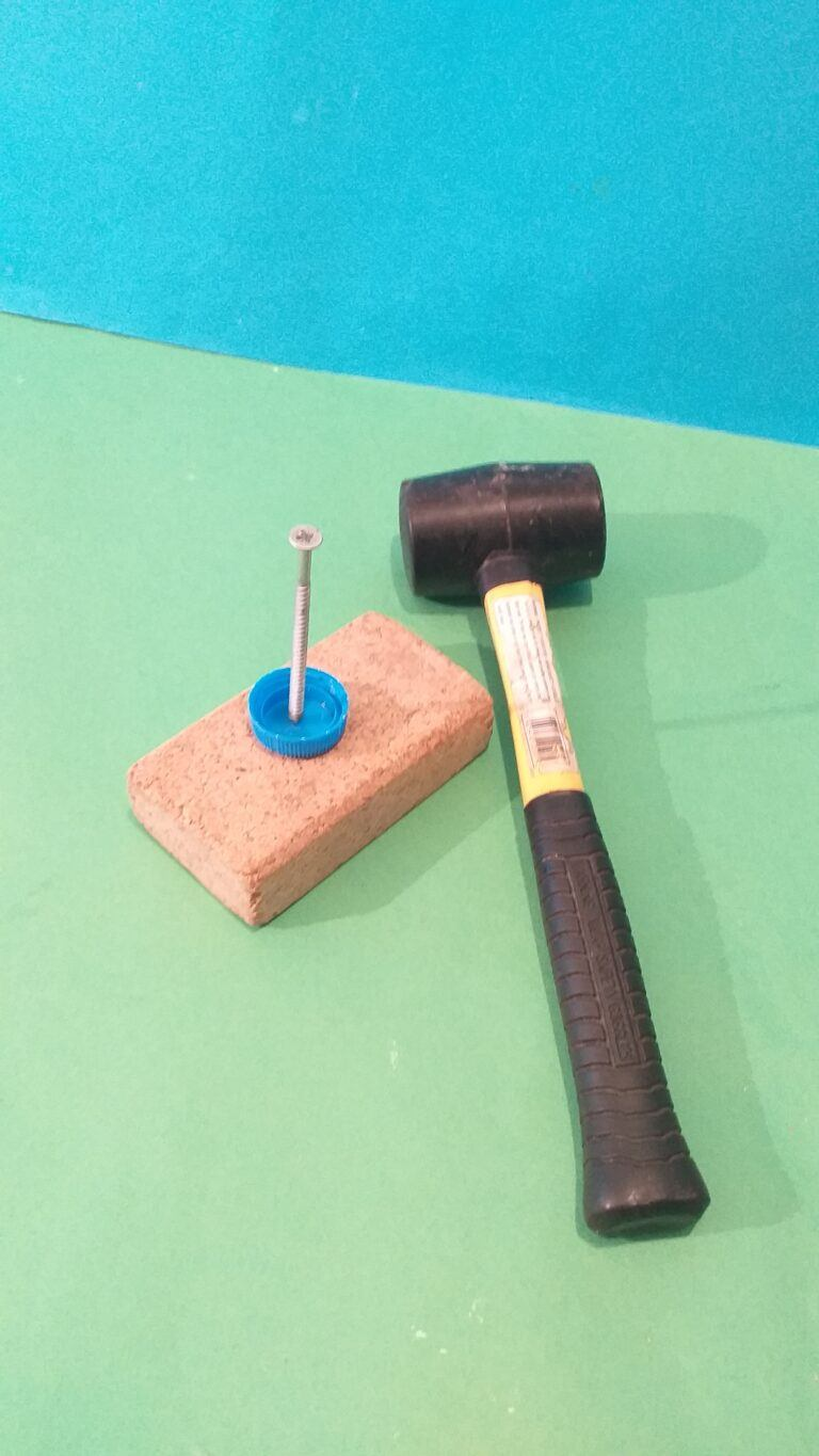 1) Hammer a screw nail into the plastic top.