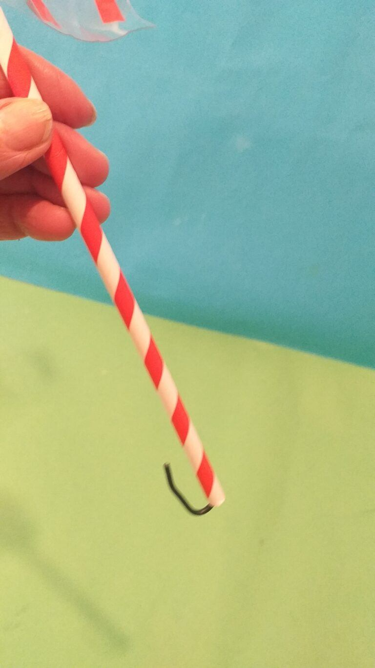 21) Run the straw up the wire and the end bit curl over so straw doesn't slide off.