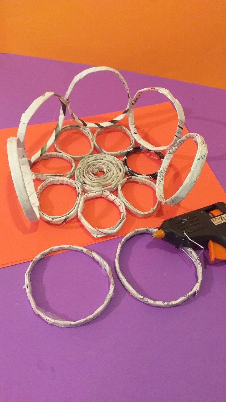 19) Once smaller rings are stuck on continue to glue the larger rings on the smaller ones and hold to adhere together.